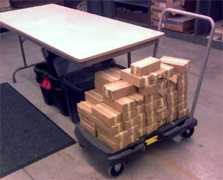 a flatbed cart with a lot of small, rectangular boxes