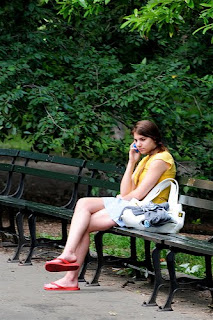 Girl in yellow with cellphone