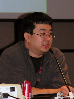 Lawrence Eng presenting a panel at Genericon XXIII