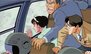 Haruko, Terada, and Hasegawa track the Z-001 in a helicopter
