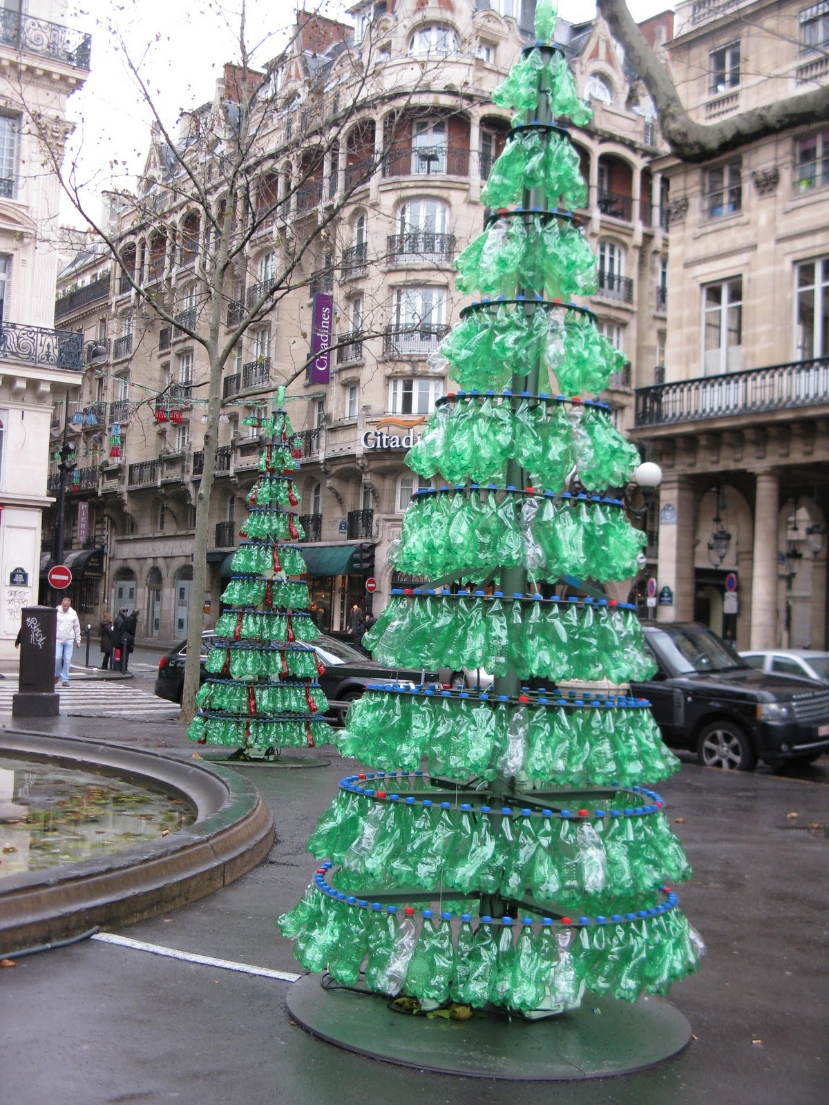 given the ridiculous amount of bottled water the french drink im glad to see that some of it is being put to good use in these christmas trees installed - What Do You Put In Christmas Tree Water