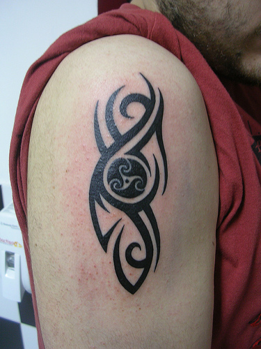 tribal tattoos for men on arm. men. tribal sleeve tattoos