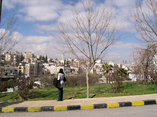An Iraqi student overlooking the densely-populated urban landscape in East Amman, Jordan. [photo: Emily Stivers, 2-28-08]