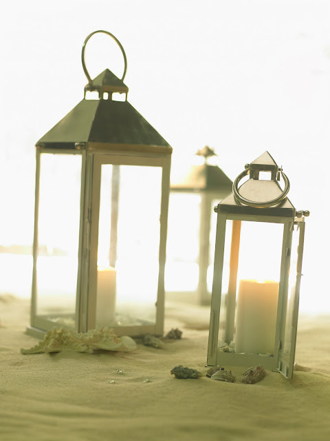 beach wedding candles in glass vases aisle runners
