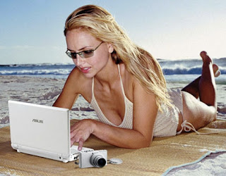sexy model on beach with gadget