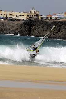 Nick Moffatt Windsurfing through the waves