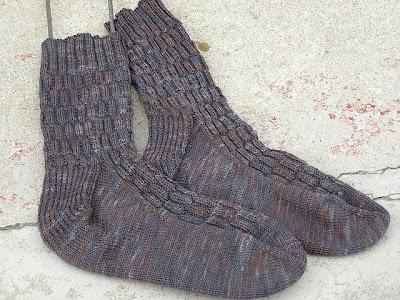 2 socks lying on cement