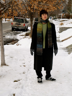 teen walking, wearing homemade scarf with his winter coat