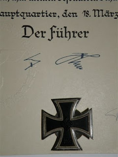 Hitler's signature on commendation certificate and a Nazi Iron Cross. Photograph by Janie Robinson, Travel Writer and Videographer.