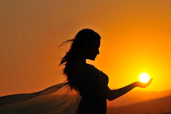 girl-holding-sun.jpg
