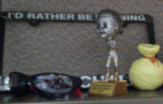 the stuff on my desk: trophy, plate frame
