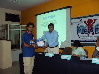 Sachin G. receiving award from Naveen jha at lead valedictory,bijapur