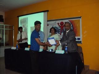 Veeresh Thalange receiving award+from Dr.Satish s+jigjini, vc,BLDE university