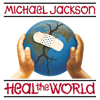 This is a photo of the album cover for Heal the World by Michael Jackson. The album has a child holding a cracked earth with a band aid over it.