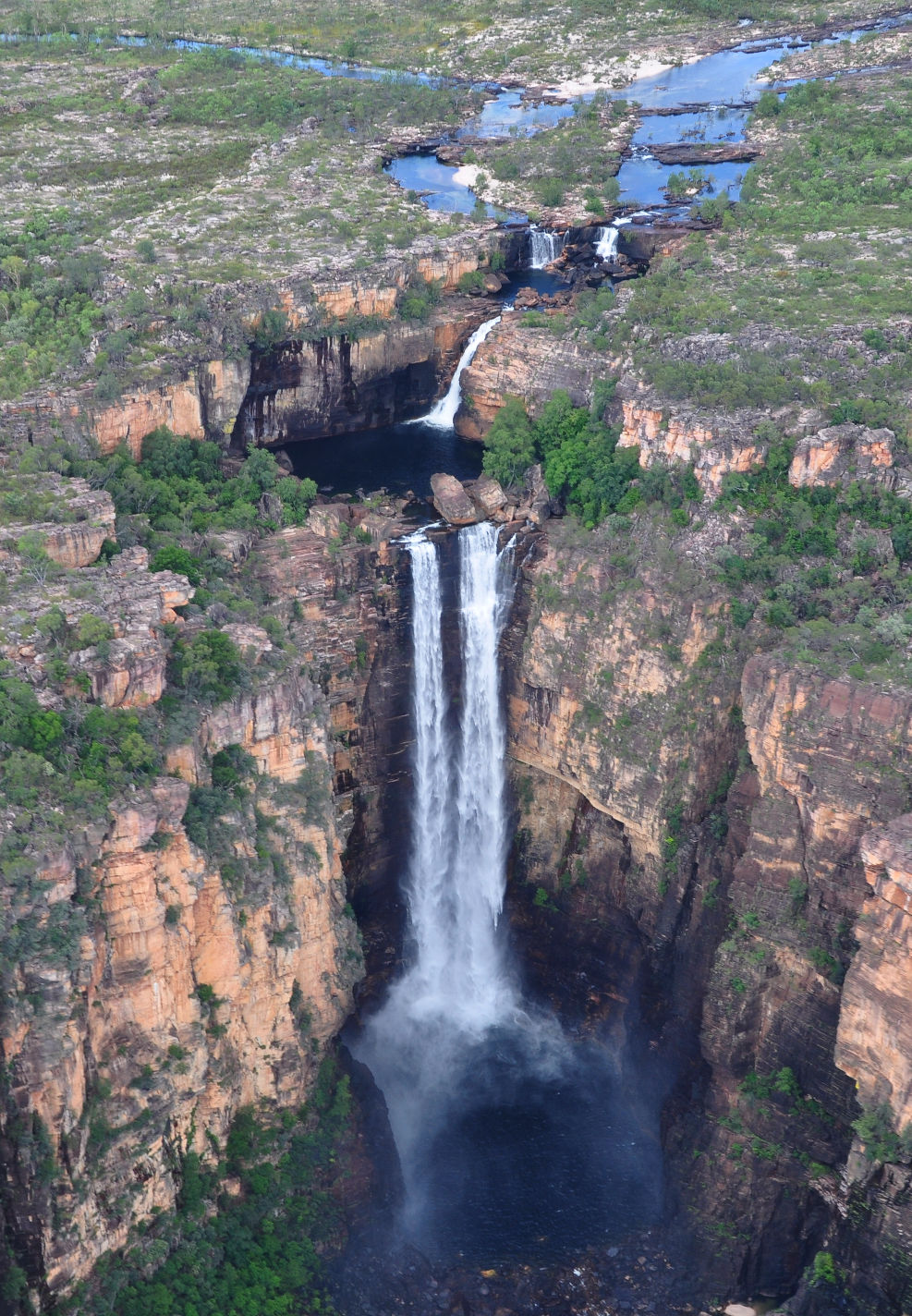 jim falls buddhist singles Significant waterfalls feature is an abrupt plunge of 268 metres down a sheer cliff to create australia's tallest single drop waterfall jim jim falls.