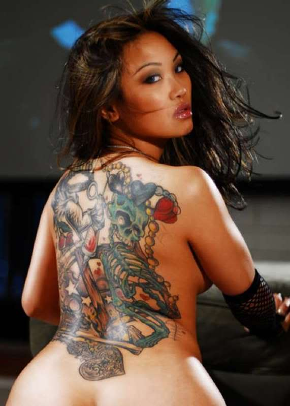 Picture 2: Tattooed ladies from New Zealand Polynesian tattoos design with