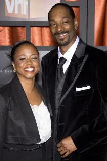 Snoop Dogg and Wife Dressed in Black and White Formal Attire