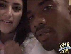 Kim Kardashian and Ray J kissing