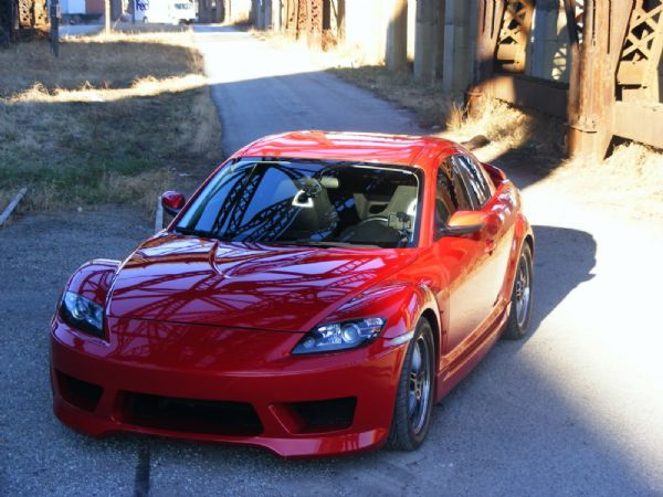 mazda rx8 modified red. this is a picture of mazda rx8 modifiikasi made in 2004 with stylish sports cars and racing modifications dominated by red paint make an impression modified