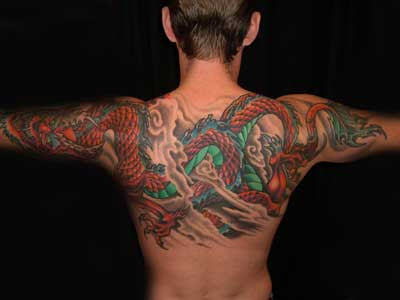 Mabek tatto a tattoo of a green dragon wrapping around for Tattoo around bicep