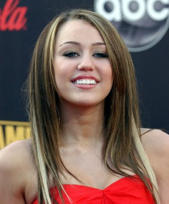 miley cyrus prom hairstyles. hilary duff hairstyles 2011.