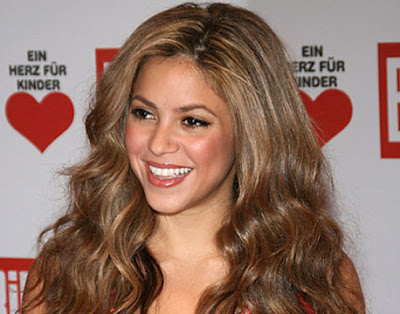 Just look at Shakira's long curly hairstyle. Shakira just see the long curly