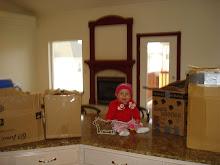 kynlee helping mom unpack