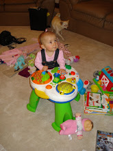 kynlee standing by her new toy