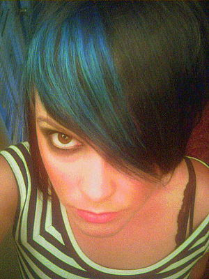 dark brown hair with blue streaks. This gorgeous emo girl has the most