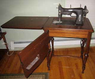 white rotary sewing machine with cabinet