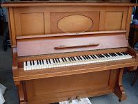 Opretstående klaver, som er det mest almindelige i private hjem