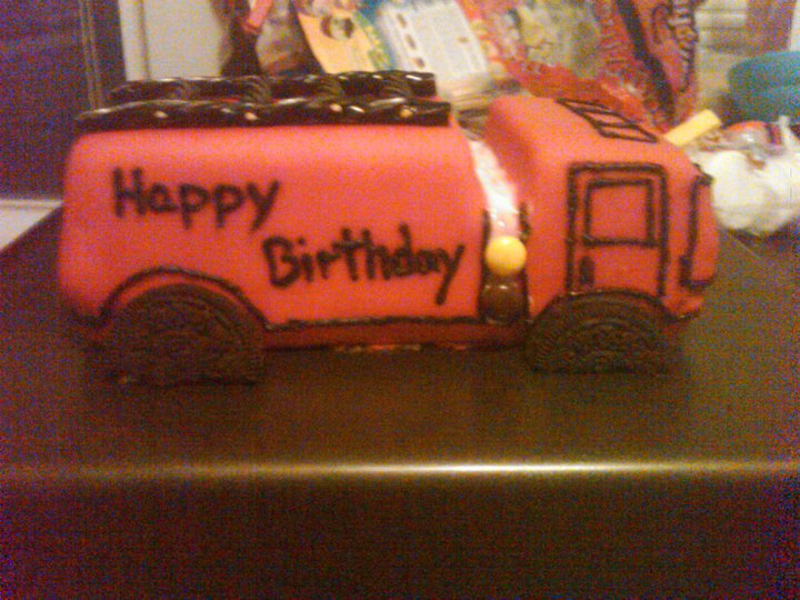 He's a firefighter so she made the cutest little firetruck out of cake.