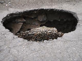 a huge pothole in the Karakorum Highway