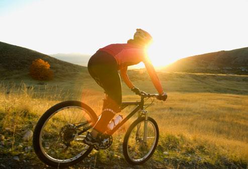 getty_rf_photo_of_woman_biking_downhill.jpg