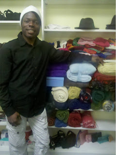 Xzavier poses with blankets in the Montrose Grace Place clothes closet