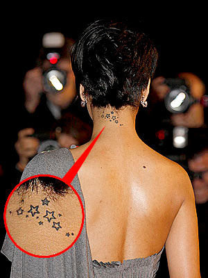 Rihanna's sexy back tattoos photos