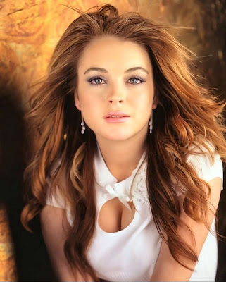 straight hair with curls at the end. Lindsay's hairstyles consist of loose end curls, soft jagged waves,