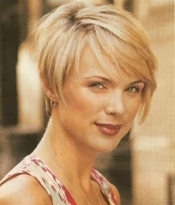 A short layered short haircut in a very light blonde was combed towards the