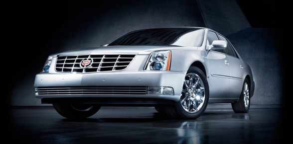 Front 3/4 view of silver 2011 Cadillac DTS