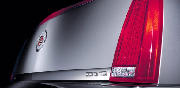 Trunk and taillight detail of silver 2011 Cadilac DTS