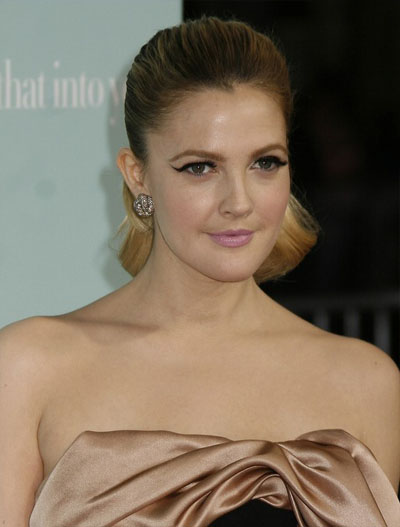 "Drew Barrymore is wearing slick ponytail hairstyle while attending ""He's"
