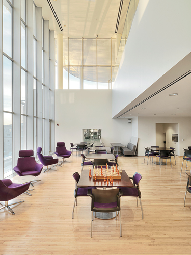 Photo  Courtesy of Anton Grassl/Esto--With sectional manipulation and  glazing, Maki has created a visual connection between a fifth-floor caf  and the ...