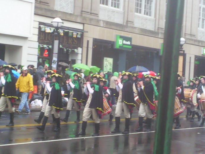 Irish band marching clear as day in front of TD Bank at the Saint Patrick's Day Parade in New Haven