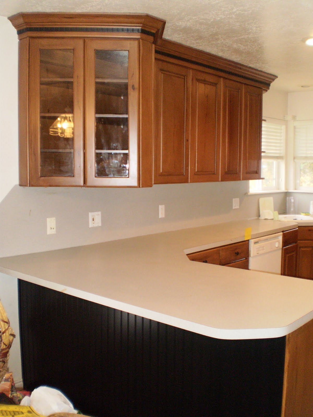 how much to refinish kitchen cabinets