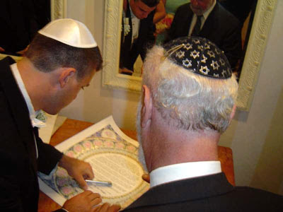 Prior to the ceremony, the two executed the traditional ketubah, or marriage ...