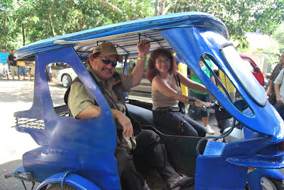 Diana Limjoco, CFO of Digital Web Group, Inc, taking Mayor Edward Hagedorn of Puerto Princesa City, Palawan for a spin on the new electric tricycle prototype.
