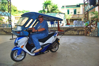 Dave Dewbre on 3000 watt motorbike attached to one of Puerto Princesa's existing tricycle sidecars for a test.