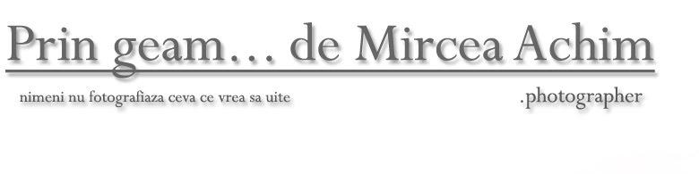 Prin geam... de Mircea Achim