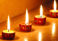 row of candle diyas pictures