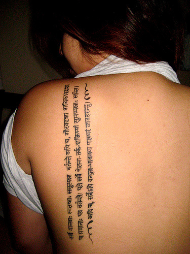 lettering tattoo on back. lettering tattoos. lettering